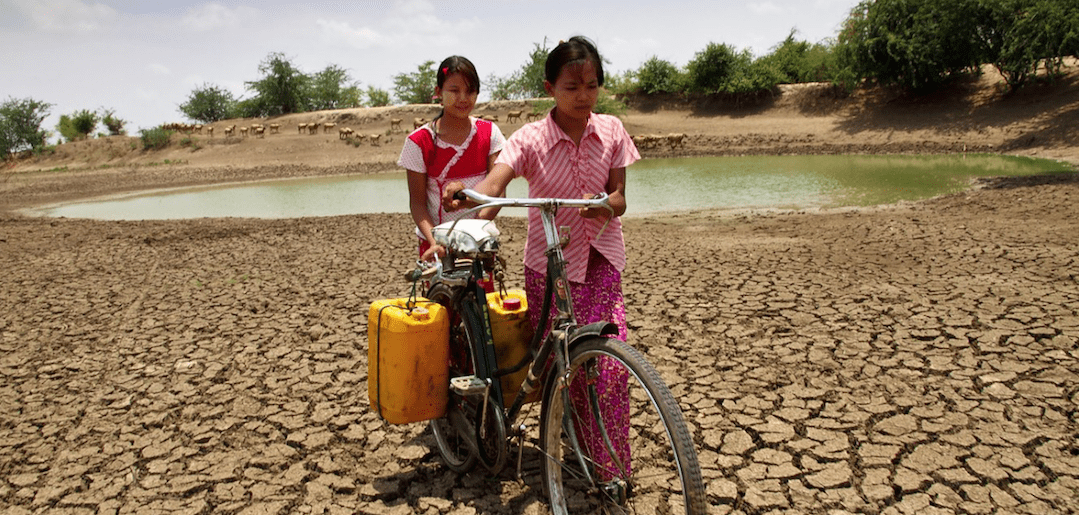 Women carrying water in Myanmar